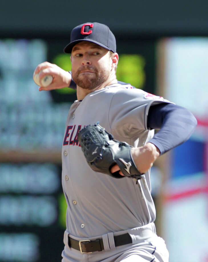 Cleveland Indians starting pitcher Corey Kluber delivers during the first inning a baseball game against the Minnesota Twins, Sunday, Sept. 21, 2014, in Minneapolis. (AP Photo/Paul Battaglia) Photo: Paul Battaglia, FRE / Associated Press / FR1768 AP