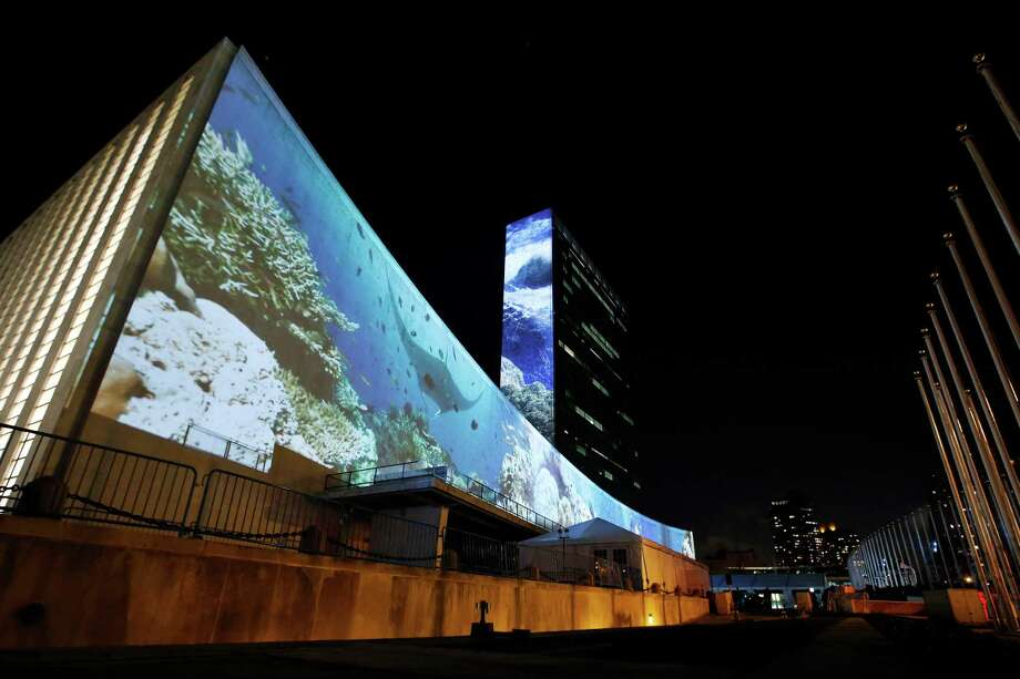 An architectural light show entitled illUmiNations: Protecting Our Planet, designed to inspire action on climate change, is projected on the side of United Nations headquarters Saturday, Sept. 20, 2014. More than 120 world leaders convene Tuesday for a U.N. summit aimed at galvanizing political will for a new global climate treaty by the end of 2015. (AP Photo/Jason DeCrow) Photo: Jason DeCrow, FRE / FR103966 AP