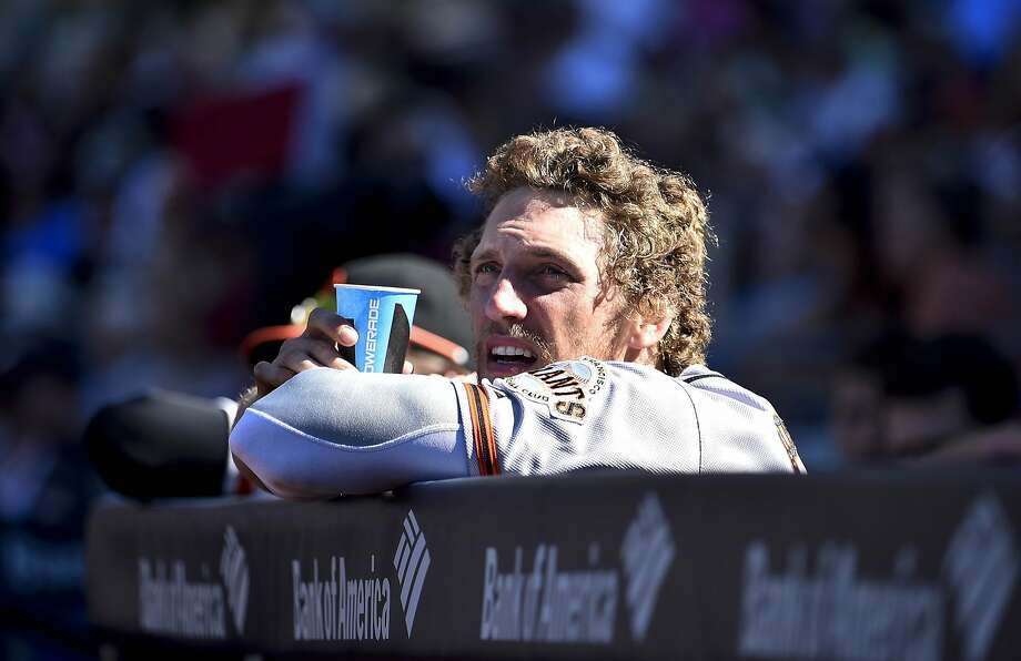 SAN DIEGO, CA - SEPTEMBER 21:  Hunter Pence #8 of the San Francisco Giants looks out from the dugout during the seventh inning of a baseball game against the San Diego Padres at Petco Park September, 21, 2014 in San Diego, California.  (Photo by Denis Poroy/Getty Images) Photo: Denis Poroy, Getty Images