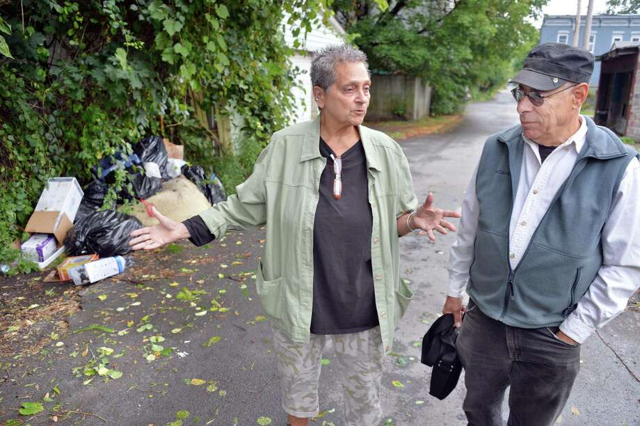 """Neighborhood leaders Sonia """"Sonny"""" Loomis, left, and Sid Fleischer point out trash along Frear Street and their efforts to clean up the South Troy neighborhood Tuesday Sept. 16, 2014, in Troy, NY.  (John Carl D'Annibale / Times Union) Photo: John Carl D'Annibale / 00028621A"""