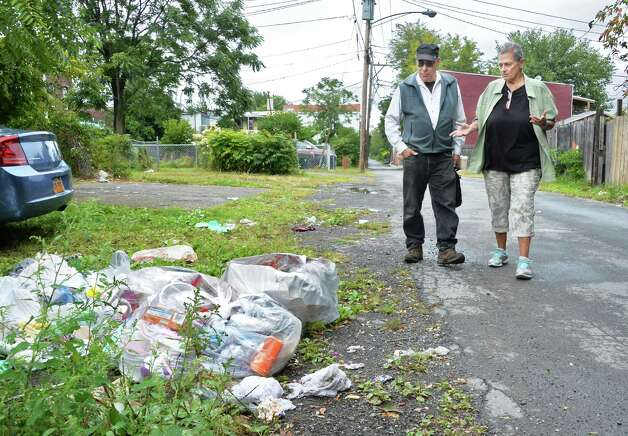 "Neighborhood leaders Sid Fleischer, left, and Sonia ""Sonny"" Loomis point out trash along Frear Street and describe their efforts to clean up the South Troy neighborhood Tuesday Sept. 16, 2014, in Troy, NY.  (John Carl D'Annibale / Times Union) Photo: John Carl D'Annibale / 00028621A"