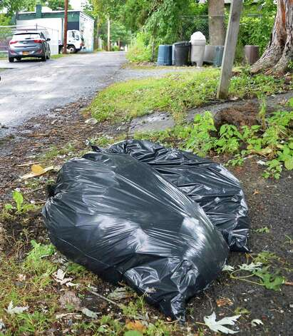 Trash bags along Franklin Street Tuesday Sept. 16, 2014, in Troy, NY.  (John Carl D'Annibale / Times Union) Photo: John Carl D'Annibale / 00028621A