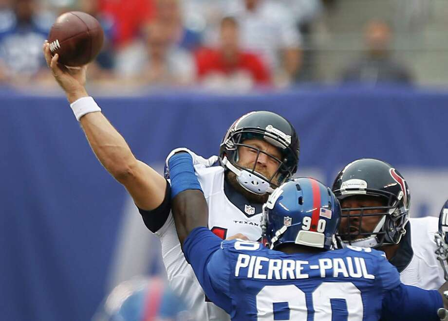 Jason Pierre-Paul and the Giants' defense hounded Texans quarterback Ryan Fitzpatrick for much of the afternoon, forcing the veteran into three interceptions. He completed just 20 of 34 passes for 289 yards. Photo: Brett Coomer, Staff / © 2014  Houston Chronicle