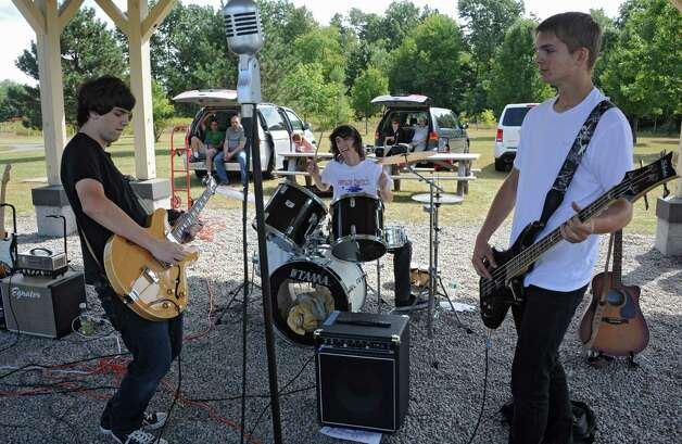 From left, Demos Efstathiou, Jordon Demarest and Herbie Knight also known as the band Rearview plays a Led Zeppelin song at The Albany Walk for Farm Animals at The Crossings of Colonie on Sunday, Sept. 21, 2014 in Colonie, N.Y. For more than 25 years, Farm Sanctuary has rescued and provided sanctuary for abused farm animals, educated the public about the routine cruelty they endure on factory farms, and advocated on their behalf. The Walks bring together thousands of people from different backgrounds in cities all across the U.S. and Canada to raise vital funds to support the organizationOs life-saving work and promote kindness towards farm animals. (Lori Van Buren / Times Union) Photo: Lori Van Buren / 00028631A