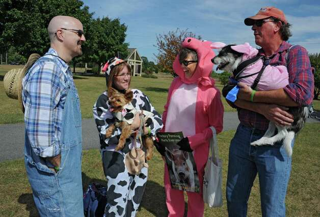 From left, Bruce Allen and Dorothy Thomas, with their dog Schmeckel, from Rotterdam, and Susan and Roger Henrickson, with their dog Barkley, of Fultonville dressed up in costumes for the The Albany Walk for Farm Animals fundraiser at The Crossings of Colonie on Sunday, Sept. 21, 2014 in Colonie, N.Y. For more than 25 years, Farm Sanctuary has rescued and provided sanctuary for abused farm animals, educated the public about the routine cruelty they endure on factory farms, and advocated on their behalf. The Walks bring together thousands of people from different backgrounds in cities all across the U.S. and Canada to raise vital funds to support the organizationOs life-saving work and promote kindness towards farm animals. (Lori Van Buren / Times Union) Photo: Lori Van Buren / 00028631A
