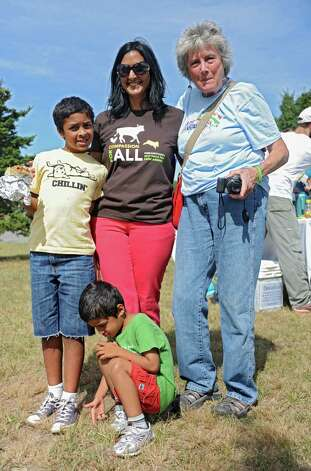 Amrit Michelle Singh of Colonie, center, poses for a photo with her sons Naveen Rutty, left, and Sohan, 5, and her friend Donna Reynolds of West Coxsackie at The Albany Walk for Farm Animals fundraiser at The Crossings of Colonie on Sunday, Sept. 21, 2014 in Colonie, N.Y. For more than 25 years, Farm Sanctuary has rescued and provided sanctuary for abused farm animals, educated the public about the routine cruelty they endure on factory farms, and advocated on their behalf. The Walks bring together thousands of people from different backgrounds in cities all across the U.S. and Canada to raise vital funds to support the organizationOs life-saving work and promote kindness towards farm animals. (Lori Van Buren / Times Union) Photo: Lori Van Buren / 00028631A