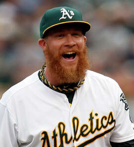 Oakland Athletics' Sean Doolittle reacts to Brandon Moss' catch to end top of 10th inning during 8-6 win over Philadelphia Phillies during MLB game at O.co Coliseum  in Oakland, Calif. on Sunday, September 21, 2014.