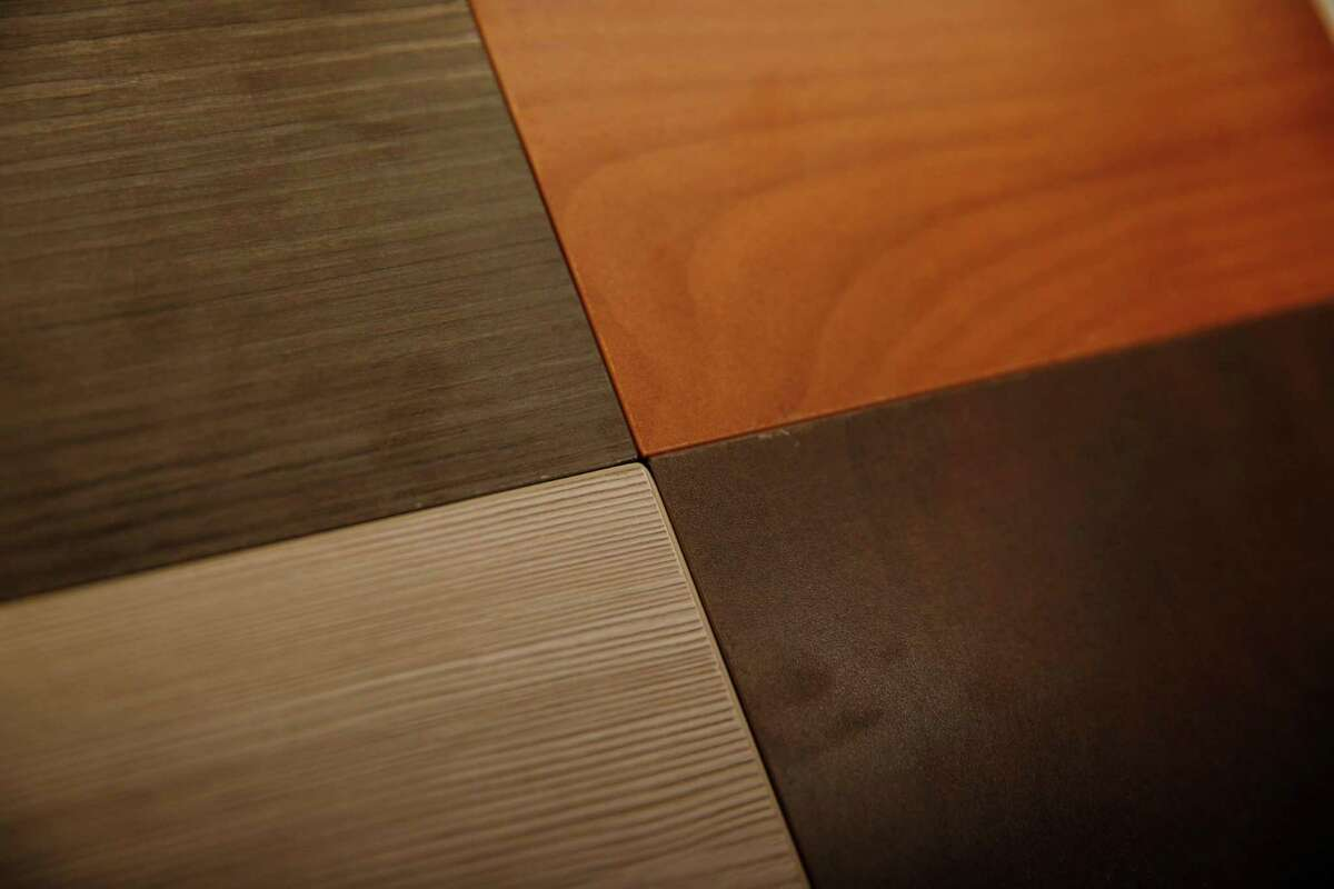 Different samples of flooring lay in a drawer in the design center at the Lumina sales gallery on Thursday, September 18, 2014 in San Francisco, Calif.