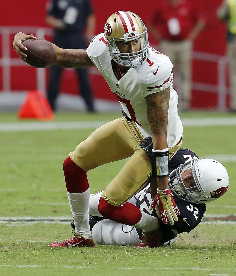 San Francisco 49ers quarterback Colin Kaepernick (7) is tackled by Arizona Cardinals free safety Tyrann Mathieu (32) during the first half of an NFL football game, Sunday, Sept. 21, 2014, in Glendale, Ariz. Photo: Rick Scuteri, Associated Press