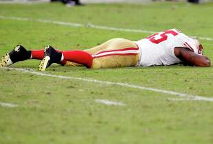San Francisco 49ers outside linebacker Ahmad Brooks lies on the field after giving up a first down and missing a sack on Arizona Cardinals quarterback Drew Stanton during the second half of an NFL football game, Sunday, Sept. 21, 2014, in Glendale, Ariz. The Cardinals won 23-14. (AP Photo/Ross D. Franklin)