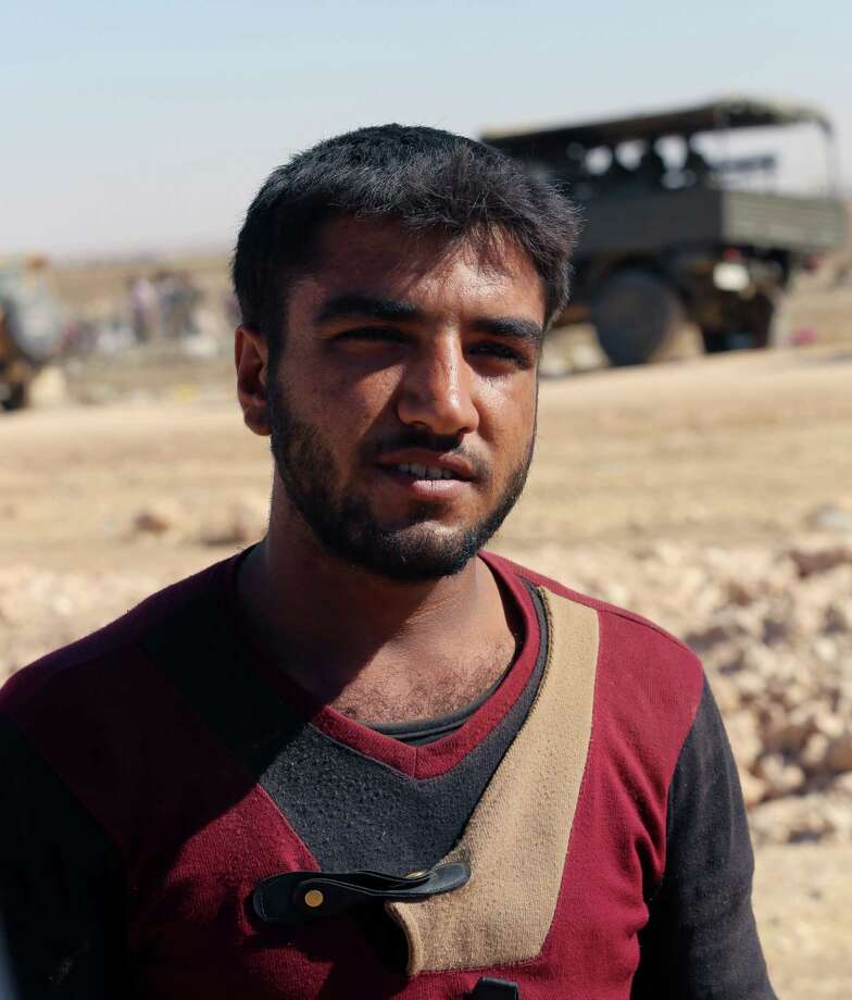 Kurdish militant Dalil Boras, 19, said he was heading back into Syria on Sunday night to fight the Islamic State. Photo: Burhan Ozbilici, STF / STR