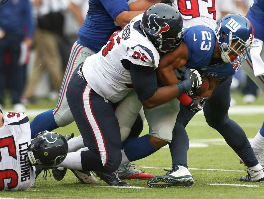 Tim Jamison and the Texans couldn't bring down the Giants' Rashad Jennings (23) fast enough throughout the game, as the running back rushed for 176 yards. Photo: Brett Coomer, Staff / © 2014  Houston Chronicle