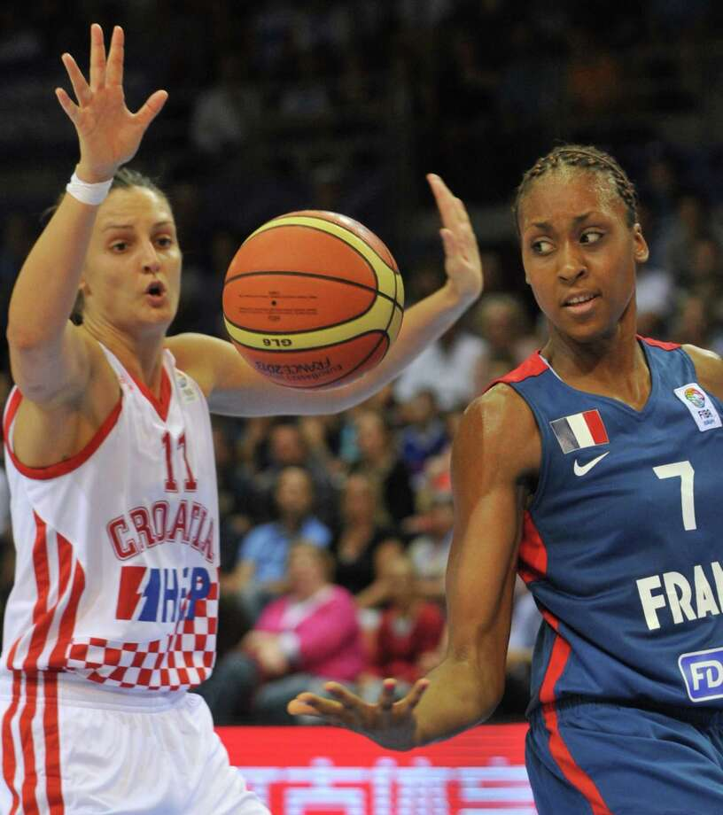 France's center Sandrine Gruda (R) vies with Croatia's forward Ana Lelas (L) during the EuroBasket Women 2013 basketball match France vs Crotia on 19 June 2013 in Mouilleron-le-Captif, western France. AFP PHOTO / FRANK PERRYFRANK PERRY/AFP/Getty Images Photo: FRANK PERRY / AFP