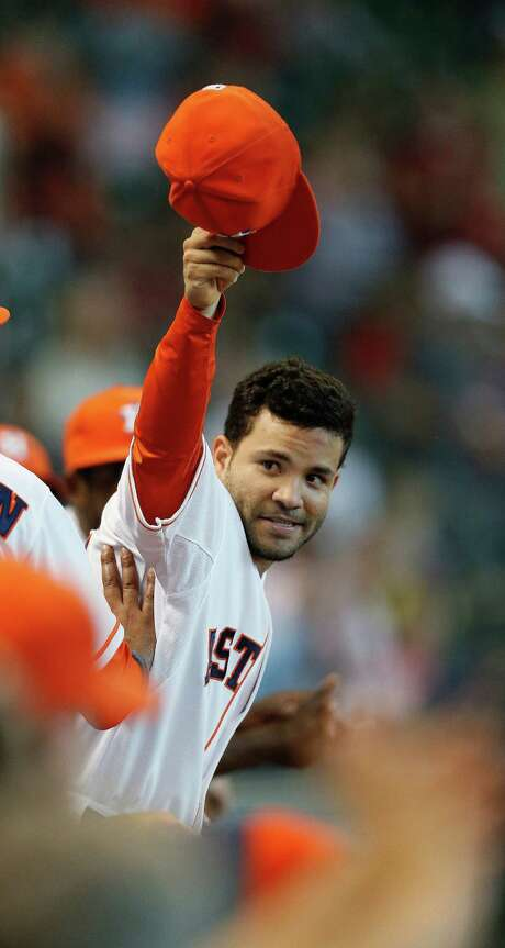 On Fan Appreciation Day, the Astros gave the crowd of 31,466 a chance for one last show of appreciation for Jose Altuve by removing the second baseman from the game in the top of the ninth inning. Photo: Karen Warren, Staff / © 2014 Houston Chronicle