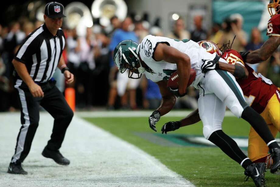 Philadelphia Eagles wide receiver Jordan Matthews drags his toes in the end zone while scoring a touchdown against the Washington Redskins during the first half of an NFL football game, Sunday, Sept. 21, 2014, in Philadelphia. Redskins strong safety Brandon Meriweather defends on the play. (AP Photo/Michael Perez) ORG XMIT: PXE205 Photo: Michael Perez / FR168006 AP