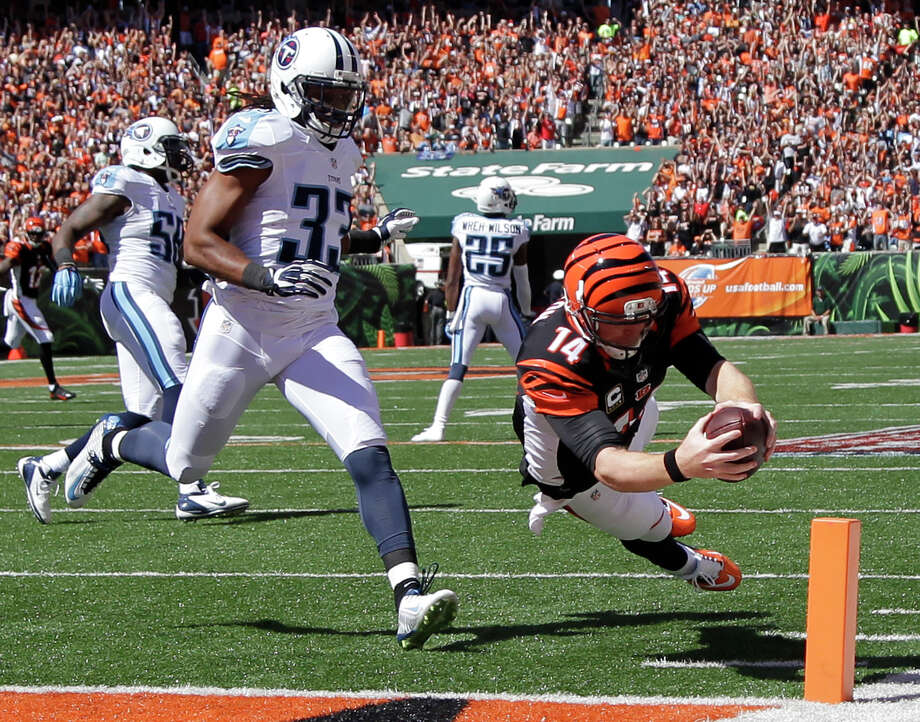 Bengals quarterback Andy Dalton dives into the end zone ahead of Titans safety Michael Griffin to score on an 18-yard pass from receiver Mohamed Sanu in the first quarter of Cincinnati's win over Tennessee. Photo: Darron Cummings, STF / AP