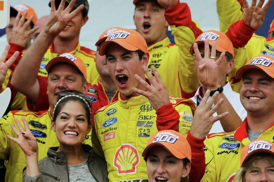 Driver Joey Logano celebrates, after winning his fourth win of the season, in Victory Lane after winning the Sylvania 300 at New Hampshire Motor Speedway, Loudon, N.H., Sunday, Sept. 21, 2014  (AP Photo/Cheryl Senter) ORG XMIT: NHCS104 Photo: Cheryl Senter / FR62846 AP