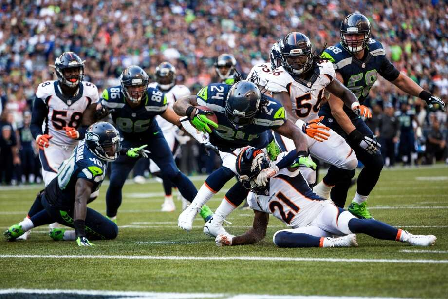 Seattle Seahawks player Marshawn Lynch flies into the endzone during a  six yard run for a touchdown in overtime against the Denver Broncos on  Sunday, September 21, 2014 at CenturyLink Field in Seattle. The Seahawks  defeated the Broncos 26-20. Photo: JORDAN STEAD, SEATTLEPI.COM
