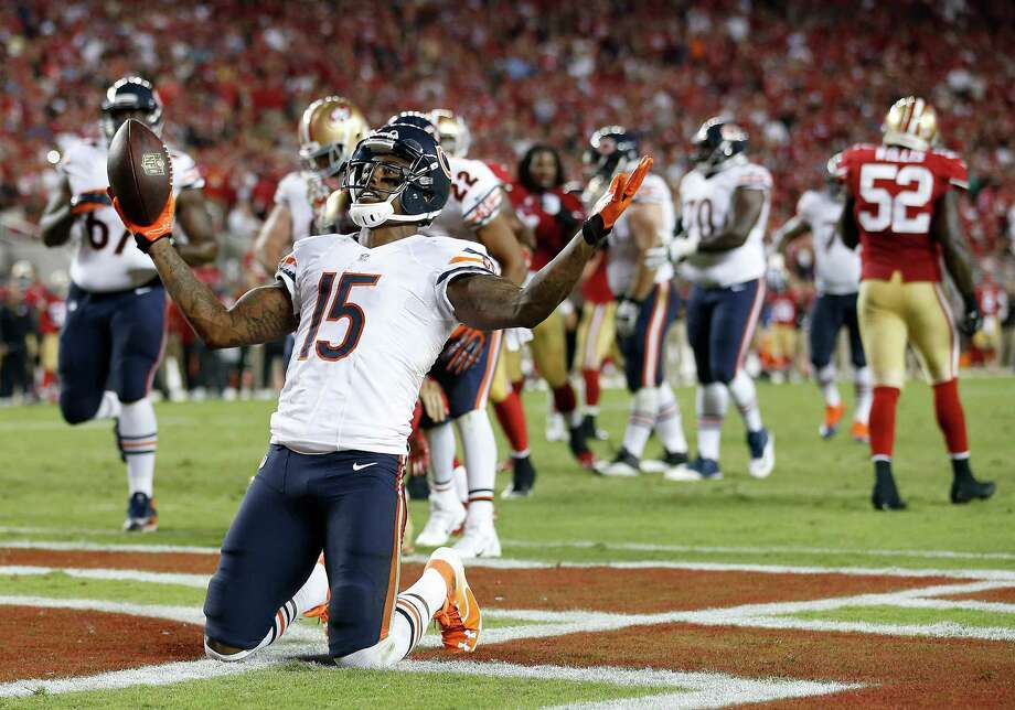 Chicago Bears wide receiver Brandon Marshall (15) celebrates after catching a 5-yard touchdown during the fourth quarter of an NFL football game against the San Francisco 49ers in Santa Clara, Calif., Sunday, Sept. 14, 2014. (AP Photo/Tony Avelar) ORG XMIT: FXN127 Photo: Tony Avelar / FR155217 AP