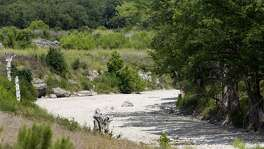 The Guadalupe River was dry Aug. 6 near Rebecca Creek Road bridge, upstream from Canyon Lake. Summer also saw springs in New Braunfels' Landa Park dry up, and San Antonio saw barely any rain in August.