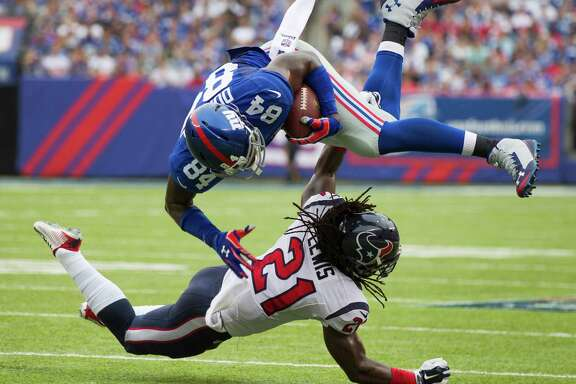 With open-field hits like this one on Giants tight end Larry Donnell (84) during the second quarter, Texans safety Kendrick Lewis (21) compiled 11 solo tackles on Sunday. He helped with one more stop.