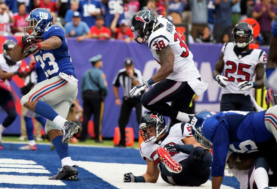 Giants running back Rashad Jennings (23) had little difficulty finding room to run against a Texans defense that allowed him to collect a career-high 176 yards. Photo: Brett Coomer, Staff / © 2014  Houston Chronicle