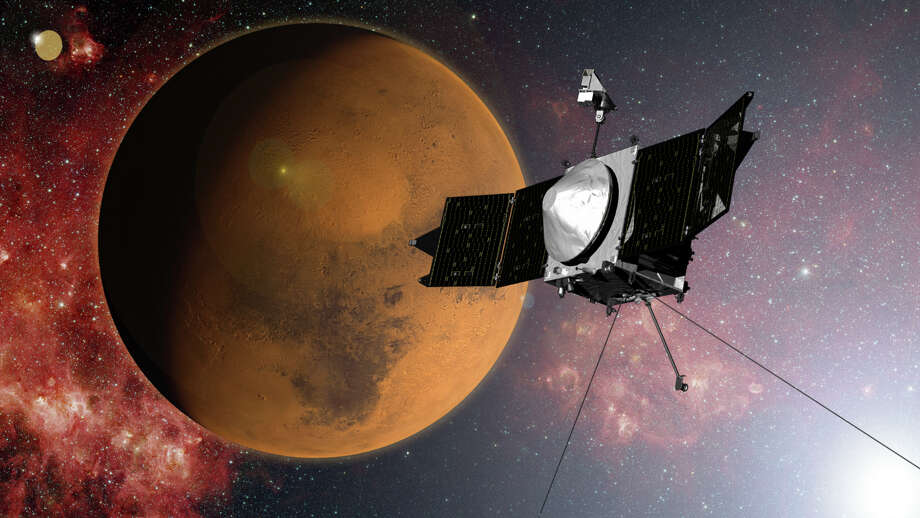 In this artist concept provided by NASA, the MAVEN spacecraft approaches Mars on a mission to study its upper atmosphere. When it arrives on Sunday Sept. 21, 2014, MAVEN's 442 million mile journey from Earth will culminate with a dramatic engine burn, pulling the spacecraft into an elliptical orbit. It's designed to circle the planet, not land. (AP Photo/NASA) Photo: HOPD / NASA