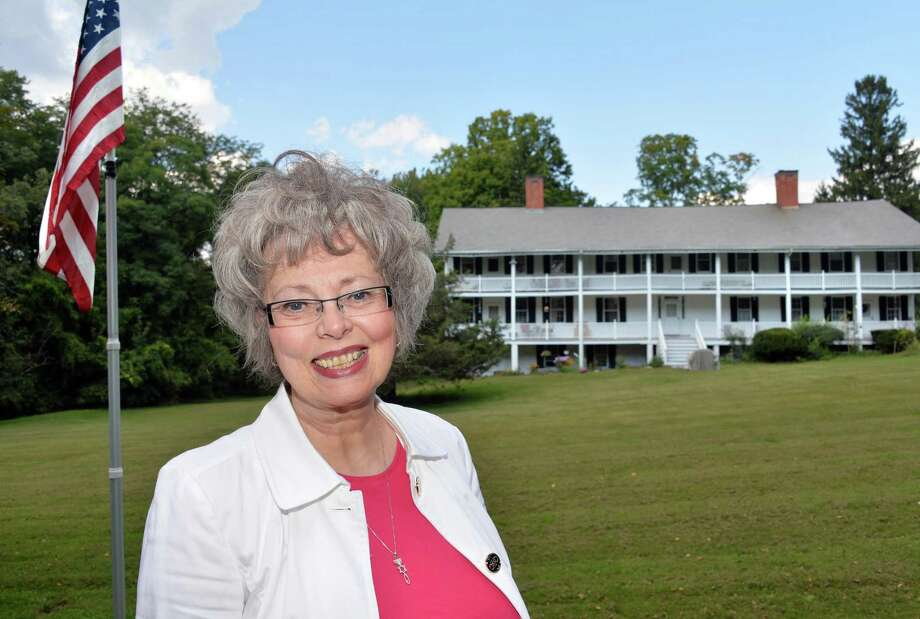 Bobbie Reno of East Greenbush stands in front of the last remaining building of the War of 1812 Greenbush Cantonment Thursday, Sept. 18, 2014, in East Greenbush, N.Y.  (John Carl D'Annibale / Times Union) Photo: John Carl D'Annibale / 00028681A