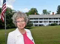 Bobbie Reno of East Greenbush stands in front of the last remaining building of the War of 1812 Greenbush Cantonment Thursday, Sept. 18, 2014, in East Greenbush, N.Y.  (John Carl D'Annibale / Times Union)