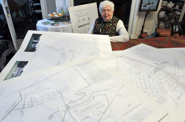 Homeowner Carol Orvis sits in her home, a former military barracks, as she shows some of the maps of the layout of the Greenbush Cantonment military barracks.  Photograph taken on Tuesday, Dec. 10, 2013 in East Greenbush, NY.    (Paul Buckowski / Times Union archive) Photo: PAUL BUCKOWSKI / adv_unknownsoldier