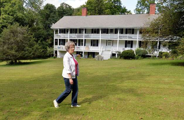 Bobbie Reno of East Greenbush walks past of the last remaining building of the War of 1812 Greenbush Cantonment Thursday, Sept. 18, 2014, in East Greenbush, N.Y.  (John Carl D'Annibale / Times Union) Photo: John Carl D'Annibale / 00028681A
