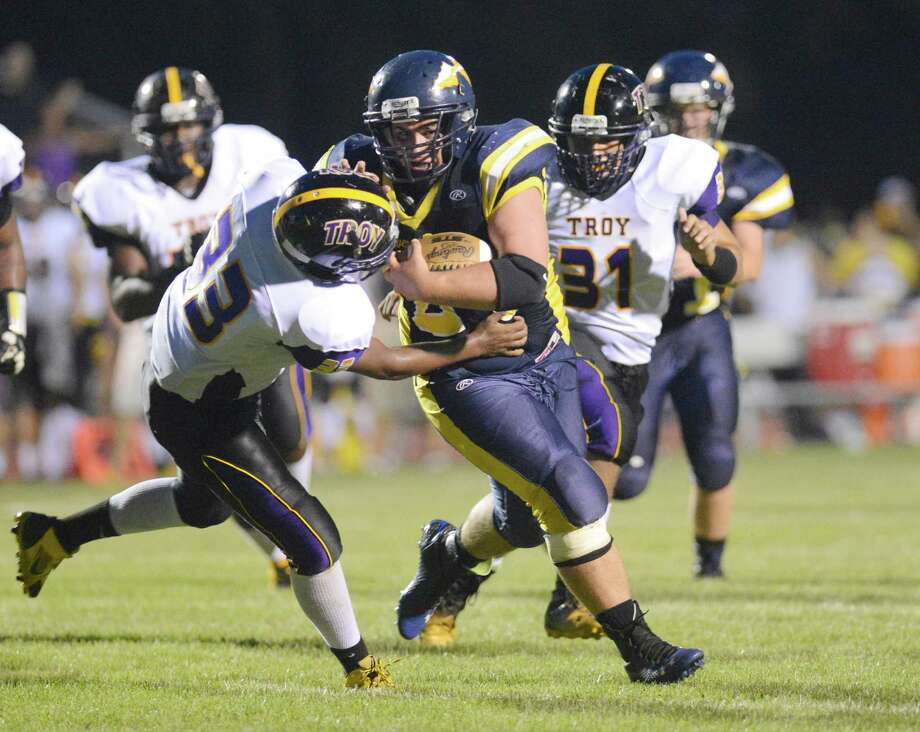 Averill Park's Garret Ryan ,right, breaks free from Troy's Raquan Harris and runs for a touchdown during the first half of their Section II Class A football game on Friday, Sept. 5, 2014, in Averill Park , N.Y., (Hans Pennink / Special to the Times Union) ORG XMIT: HP108 Photo: Hans Pennink / Hans Pennink