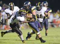 Averill Park's Garret Ryan ,right, breaks free from Troy's Raquan Harris and runs for a touchdown during the first half of their Section II Class A football game on Friday, Sept. 5, 2014, in Averill Park , N.Y., (Hans Pennink / Special to the Times Union) ORG XMIT: HP108