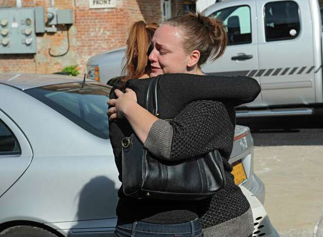Amanda Conant, right, daughter of Daniel Satre hugs Mila, (she didn't wish to give her last name), girlfriend of Daniel Satre, say goodbye after a press conference about an investigation over the death of Daniel Satre of Ballston Spa on Sunday, Sept. 21, 2014 in Ballston Spa, N.Y. Satre was Tasered by police multiple times after resisting arrest for disorderly conduct late Saturday night. (Lori Van Buren / Times Union) Photo: Lori Van Buren / 00028713A