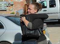 Amanda Conant, right, daughter of Daniel Satre hugs Mila, (she didn't wish to give her last name), girlfriend of Daniel Satre, say goodbye after a press conference about an investigation over the death of Daniel Satre of Ballston Spa on Sunday, Sept. 21, 2014 in Ballston Spa, N.Y. Satre was Tasered by police multiple times after resisting arrest for disorderly conduct late Saturday night. (Lori Van Buren / Times Union)