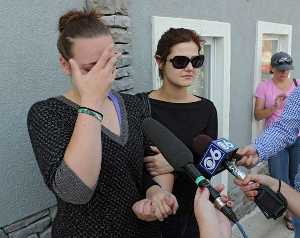 Amanda Conant, left, daughter of Daniel Satre and Mila, (she didn't wish to give her last name), girlfriend of Daniel Satre speak to the reporters after a press conference about an investigation over the death of Daniel Satre of Ballston Spa who was Tasered by police multiple times after resisting arrest for disorderly conduct late Saturday night on Sunday, Sept. 21, 2014 in Ballston Spa, N.Y. (Lori Van Buren / Times Union) Photo: Lori Van Buren / 00028713A