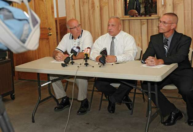 From left, Saratoga County Sheriff Mike Zurlo, Ballston Spa  Chief of Police Charles Koenig and state police Lt. Don Williams hold a press conference about an investigation over the death of Daniel Satre of Ballston Spa who was Tasered by police multiple times after resisting arrest for disorderly conduct late Saturday night on Sunday, Sept. 21, 2014 in Ballston Spa, N.Y. (Lori Van Buren / Times Union) Photo: Lori Van Buren / 00028713A