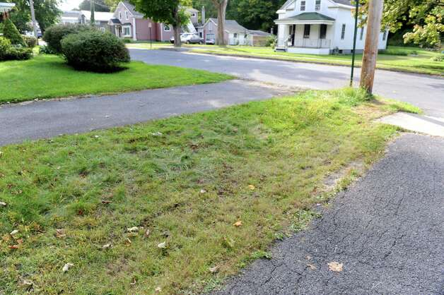 Strip of grass near Daniel Satre's home where a confrontation occurred between him and the police Sunday, Sept. 21, 2014 in Ballston Spa, N.Y. Satre was Tasered by police multiple times after resisting arrest for disorderly conduct late Saturday night. (Lori Van Buren / Times Union) Photo: Lori Van Buren / 00028713A