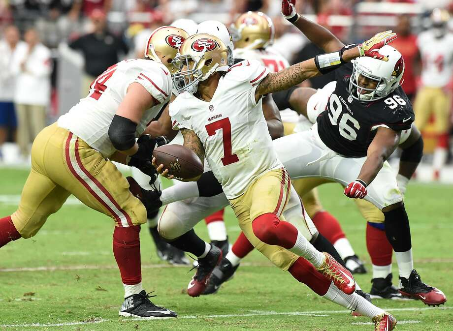 GLENDALE, AZ - SEPTEMBER 21: Quarterback Colin Kaepernick #7 of the San Francisco 49ers scrambles against defensive end Kareem Martin #96 of the Arizona Cardinals during the third quarter of the NFL game at University of Phoenix Stadium on September 21, 2014 in Glendale, Arizona.  (Photo by Norm Hall/Getty Images) Photo: Norm Hall, Getty Images