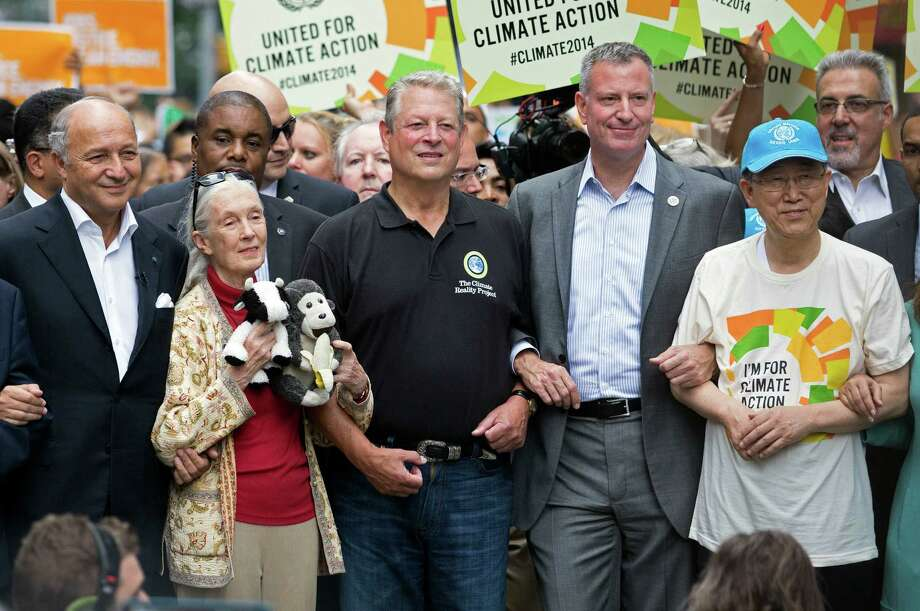French Foreign Minister Laurent Fabius, from left, primatologist Jane Goodall, former U.S. Vice President Al Gore, New York Mayor Bill de Blasio, and  U.N. Secretary General Ban Ki-moon participate in the People's Climate March in New York, Sunday, Sept. 21, 2014. Thousands of demonstrators filled the streets of Manhattan on Sunday, accompanied by drumbeats, wearing costumes and carrying signs as they urged policy makers to take global action on climate change. Photo: Craig Ruttle, AP / FR61802 AP