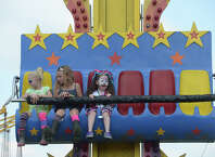Carnival-goers, including Hollierose Justice, 5, (far right) enjoy a ride at the annual Pecan Festival in Groves Sunday.  Photo taken Friday, September 19, 2014 Kim Brent/@kimbpix