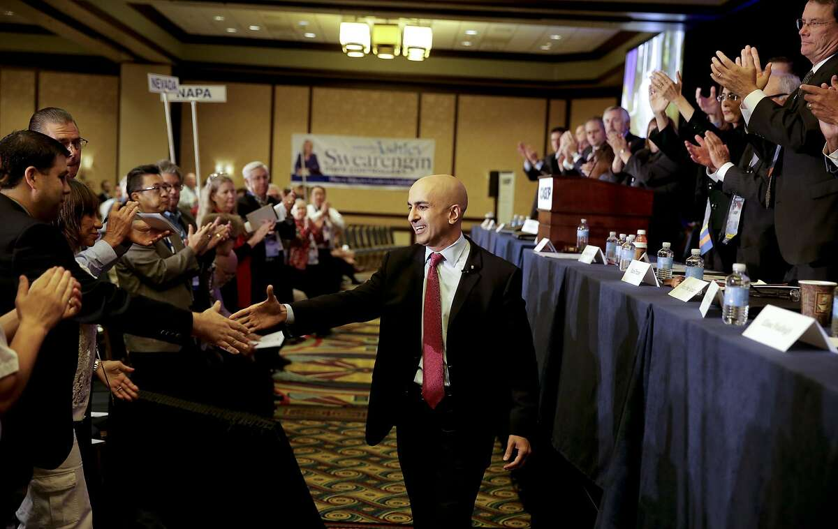 Republican candidate for California governor Neel Kashkari greets supporters after speaking during general assembly meeting at the California GOP convention on Sunday, Sept. 21, 2014 in Los Angeles. Nowhere has the effort to attract a new generation of Republicans been more fraught than in left-leaning California, where the GOP's registration has slid to 28.5 percent _ just a few percentage points above the 21 percent of registered voters who are unaffiliated with any party.