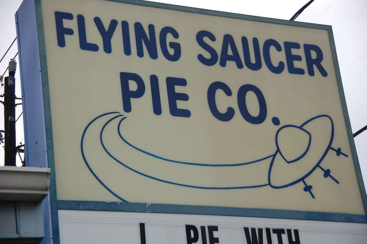 """Sign for Flying Saucer Pie Co.: """"The design for Flying Saucer has been the same since it was created in the late '70s, a few years after the shop opened... That's the funny thing about the Space Age. Dreams outpaced reality by so many miles that visions of the future faded into nostalgia almost the instant they were rendered-like being dazzled by light from a star already collapsed."""""""