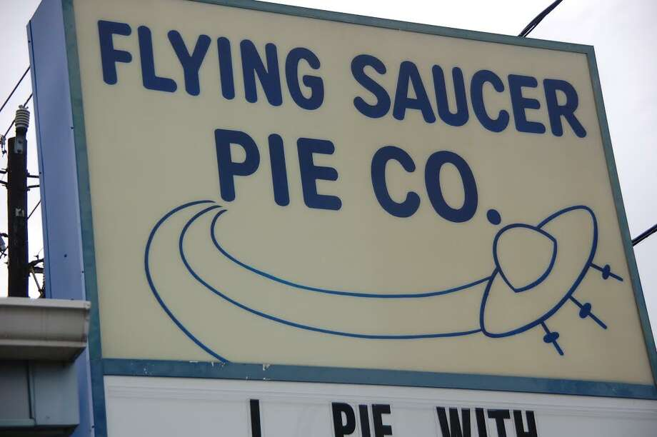"""Sign for Flying Saucer Pie Co.: """"The design for Flying Saucer has been the same since it was created  in the late '70s, a few years after the shop opened... That's the funny thing about the Space Age. Dreams outpaced  reality by so many miles that visions of the future faded into nostalgia  almost the instant they were rendered—like being dazzled by light from a  star already collapsed."""""""