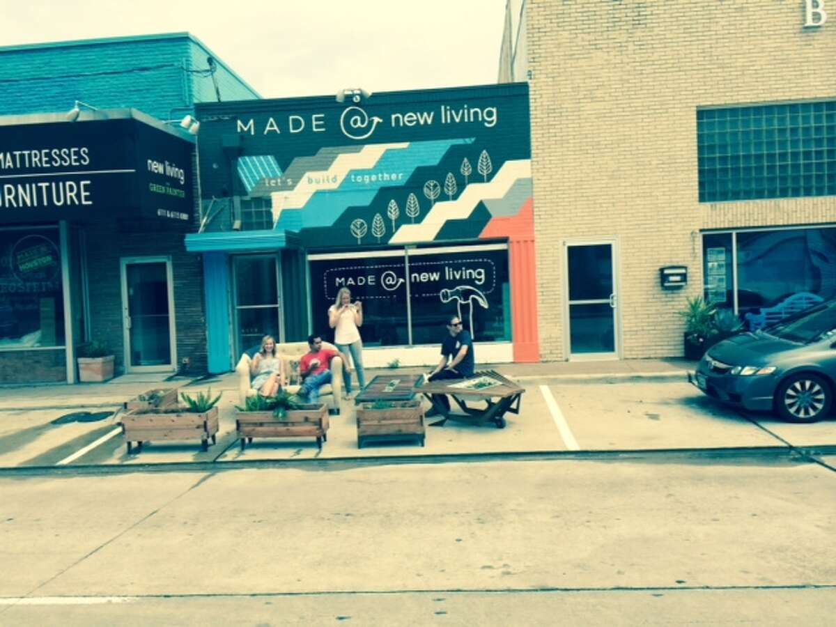 From PARK(ing) Day 2014: In the Rice Village, New Living employees hang out in a temporary micro-park, or parklet on Kirby.