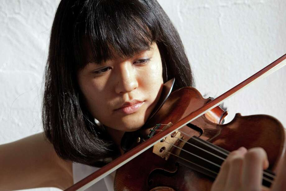 Violinist Akiko Kobayashi, above, will join pianist Eric Siepkes at the First Presbyterian Church of New Canaan Sunday, Sept. 28, as part of the churchís Coffee Concerts. Photo: Contributed Photo, Contributed / New Canaan News Contributed