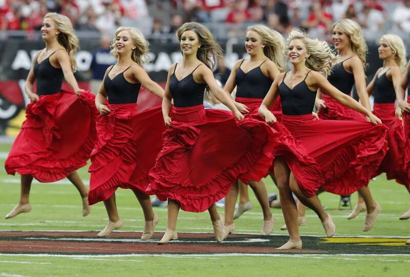 The Arizona Cardinals cheerleaders perform in honor of Hispanic Heritage Month during the first half