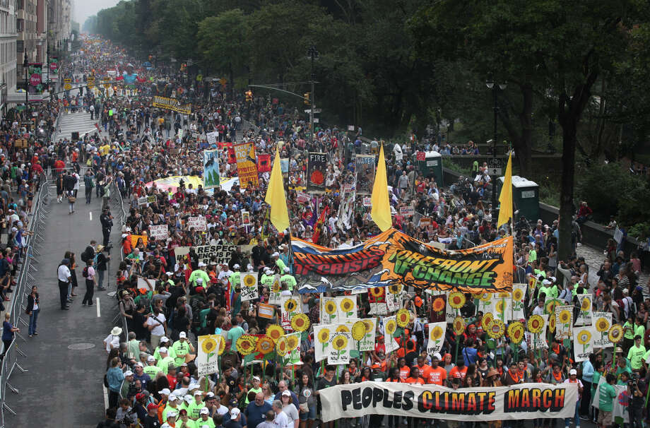 More than 100,000 people marched through midtown Manhattan on Sunday as part of the People's Climate March, a worldwide clean-energy movement. Photo: John Minchillo, FRE / Associated Press / AP Images