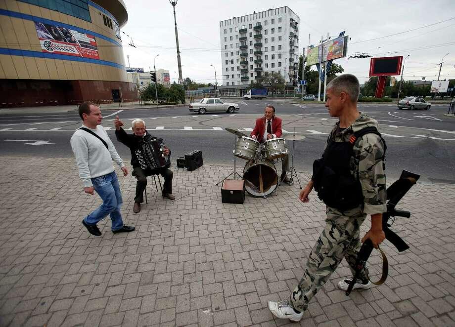 Street musicians perform in the town of Donetsk in eastern Ukraine. Photo: Darko Vojinovic, STF / Associated Press / AP