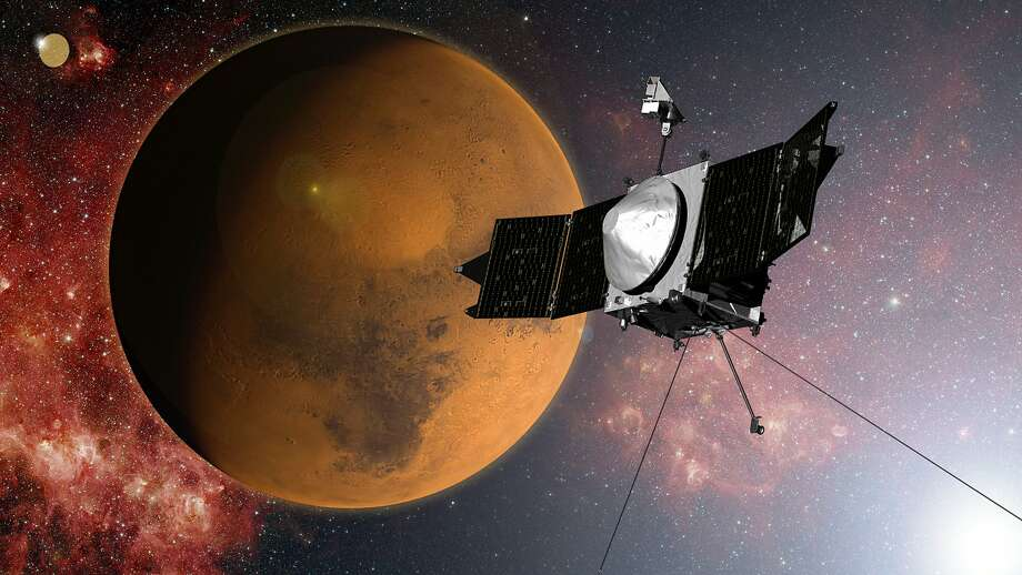 In this artist concept provided by NASA, the MAVEN spacecraft approaches Mars on a mission to study its upper atmosphere. Late Sunday night, Sept. 21, 2014,NASA's Maven spacecraft entered orbit around Mars for an unprecedented study of the red planet's atmosphere following a 442 million-mile journey that began nearly a year ago. Photo: Associated Press